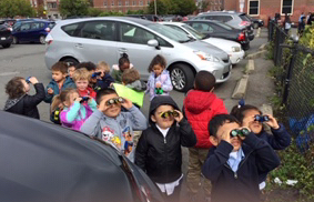In the parking lot using our binoculars
