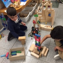 Pre-K students practicing their engineering skills building treehouses